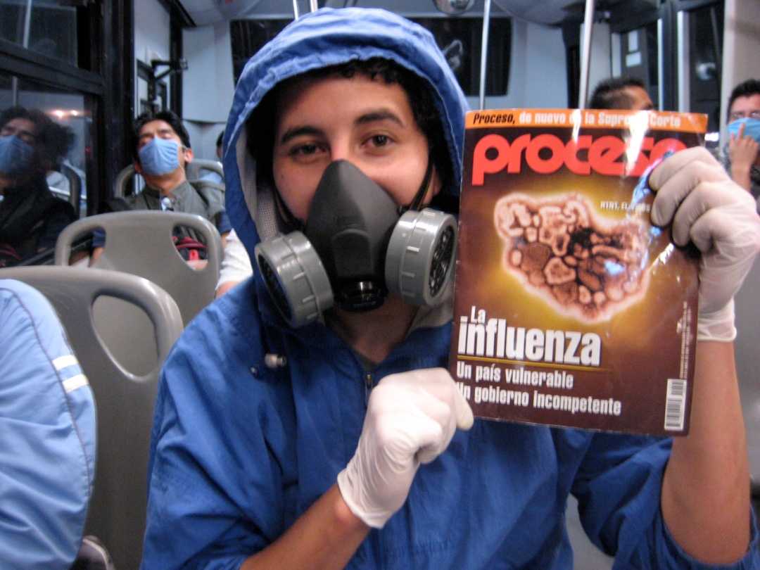 THE RIGHT GEAR: Mexico City  bus rider holds up the latest issue of the Mexican news magazine Proceso, featuring a story on swine influenza.