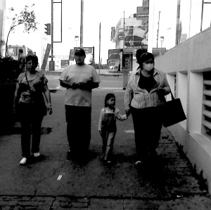 PROTECT YA NECK: A family on Cuauhtémoc Avenue in Mexico City. While the government issued health warnings urging people to stay inside or wear face-masks when venturing outside, you can see some choosed to ignore it.